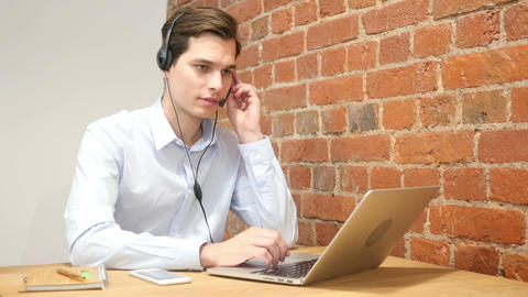 Company representative using headset to talk on the hot line Footage