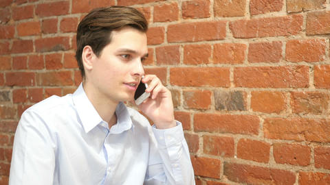a casual young professional man talking on phone Footage