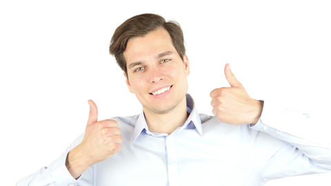 Man extremely happy gesturing thumbs up against white background Footage