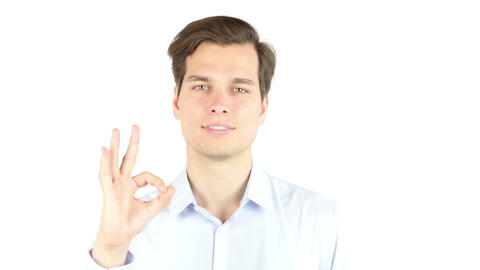 Everything is OK! Happy young man gesturing OK sign and smiling Footage