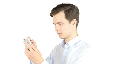 Happy young businessman using smartphone Footage