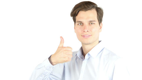 Side view of businessman giving thumb up against a white background Footage