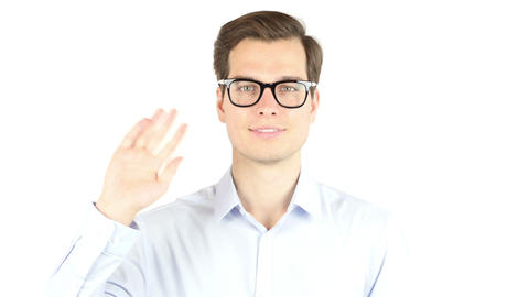 Saying hello to someone. Handsome businessmen greeting someone isolated on white Footage