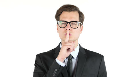 Closeup portrait handsome, businessman , finger on the lips. sign for silence Footage