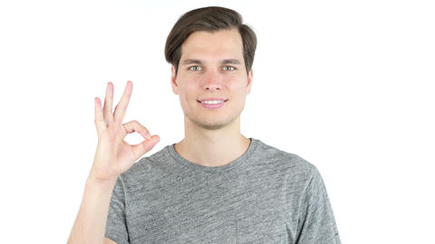 Young Man shows sign of Okay, All is well, Isolated on White Background Footage