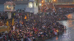 Crowds during Ganga Aarti with candles and man gives fire,Haridwar,India Footage