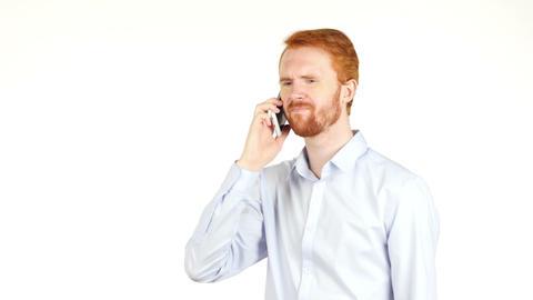 Portrait of angrybusinessman talking on smartphone , crisis , bad news Footage