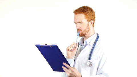 Doctor, surgeon reading medical reports , white background Footage