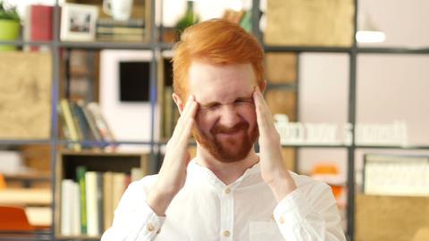 Man having a headache at Work Footage