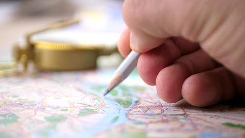 Men Planning River Rafting Trip on Map Live Action