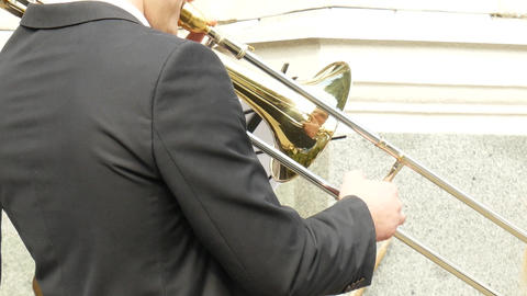 Male trombone player during an outdoor concert Footage