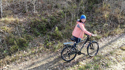 Cyclist Woman Riding On Bicycle On Countryside Road in autun forest, Having Fun Footage