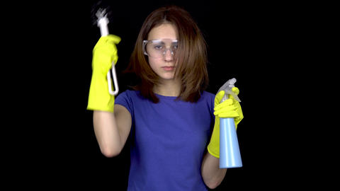 A young woman combing her hair with a toilet brush. Woman in safety glasses and Footage