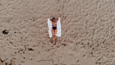 Pretty woman on summer vacation at the beach Footage