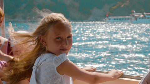 Beautiful girl enjoying sea walk on speed boat at sunny day. Cute teenager girl Footage
