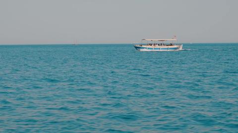 Speed boat floating on sea cruise on horizon background. Tourist people sailing Footage