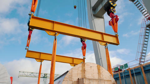 Cargo shipping - men workers in protective helmets taking control of the cargo Live Action