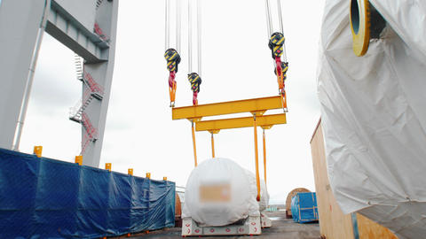 Cargo shipping - lifting and moving the cargo on the long ropes Live Action