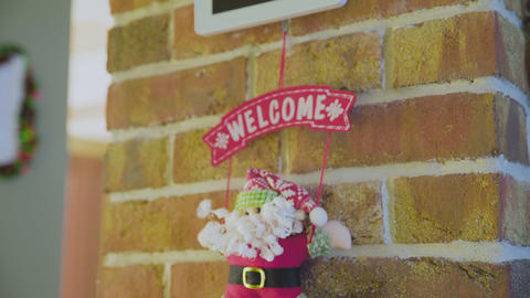 Toy Santa hang on wall with WELCOME sign GIF