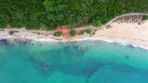 Flight over amazing sandy beaches at the ocean in paradise Live Action