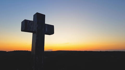 Stone cross on top of a mountain against a sunset. Cross... Stock Video Footage