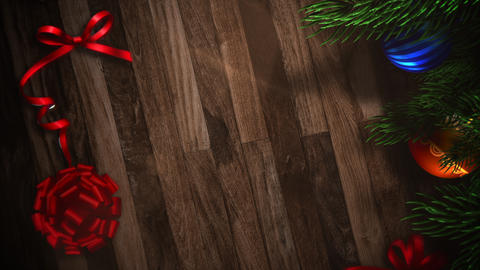 Animated closeup gift boxes and green tree branches with balls on wood background Animation