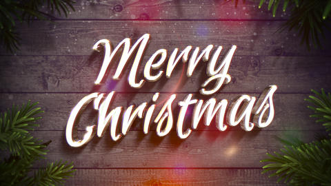 Animated close up Merry Christmas text, colorful garland and green Christmas branch on wood Animation