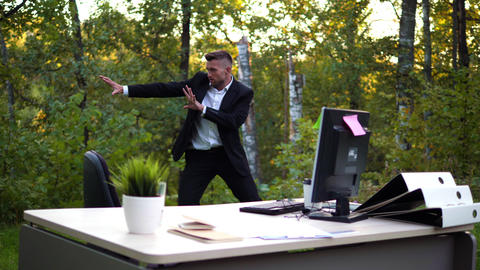 Officeworker is training on a fresh air Live Action