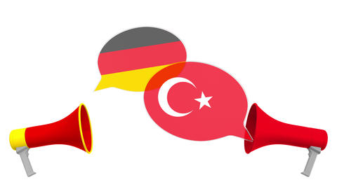 Speech bubbles with flags of Turkey and Germany. Intercultural dialogue or Live Action