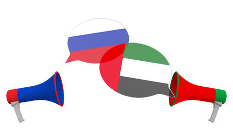 Flags of the UAE and Russia on speech balloons from megaphones. Intercultural Live Action