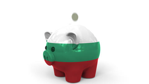 Coins fall into piggy bank painted with flag of Bulgaria. National banking Live Action