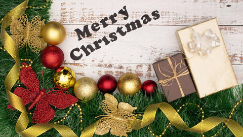 Merry Christmas title moving surrounded with beautiful Christmas decoration of gold and red Animation