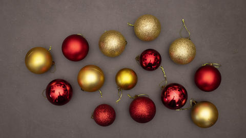 Christmas gold and red balls appearing on grey background - Stop motion animation Animation