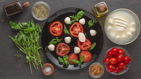 insalata caprese, italian caprese, buffalo mozzarella cheese, fresh tomatoes, fresh tomatoes, sliced Live Action