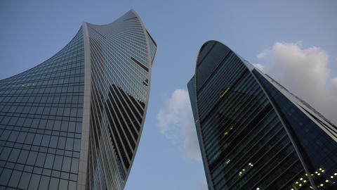 Two newly built skyscrapers. Skyscrapers are in Moscow city. View from below Live Action