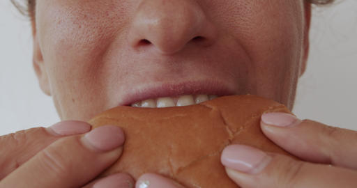 Woman eating burger, unhealthy eating, close-up lips Footage