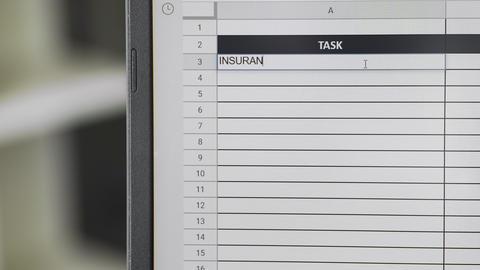 Person marking task INSURANCE in online plan, to-do list ビデオ