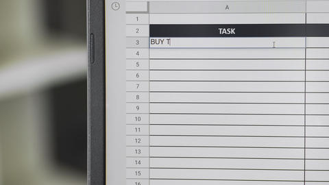 Person marking task BUY TICKETS in online plan, to-do list ビデオ