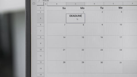 Writing DEADLINE on 1th on calendar to remember this date Live Action