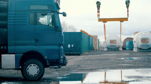 Cargo shipping - a big shipping truck arriving on the construction site Live Action