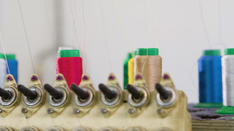 Industrial sewing machines with colorful sewing thread Live Action