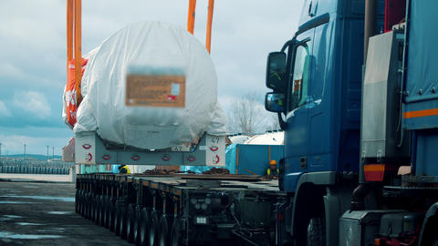 Cargo shipping - a big truck approaches under the cargo Live Action