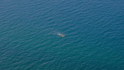 Woman in yellow swimsuit swimming in the sea, nobody Live Action