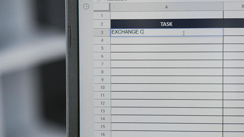 Person marking task EXCHANGE CURRENCY in online plan, to-do list Live Action