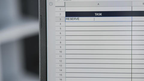 Person marking task RESERVE HOTEL ROOM in online plan, to-do list Live Action