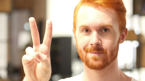 Man showing peace sign , victory sign Live Action