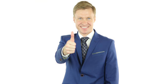 Smiling businessman with thumb up, isolated on White Background Footage