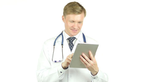 happy healthcare worker using tablet computer, white background Footage