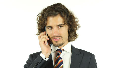 Handsome young business man talking on smartphone smiling happy Footage