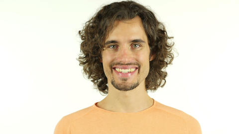 Portrait of mid adult man smiling against white background Live Action
